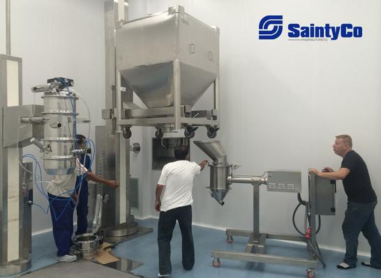 Technicians testing SaintyCo bin blender