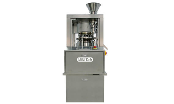 Rotary table compression machine
