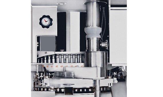 Compression system for tablet press